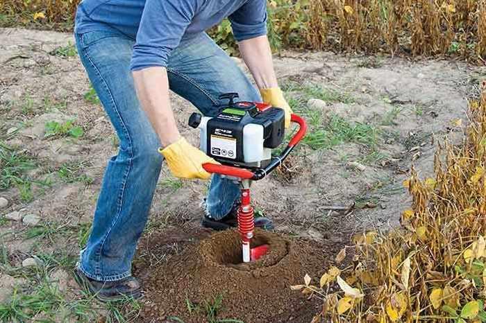 man working on his yard