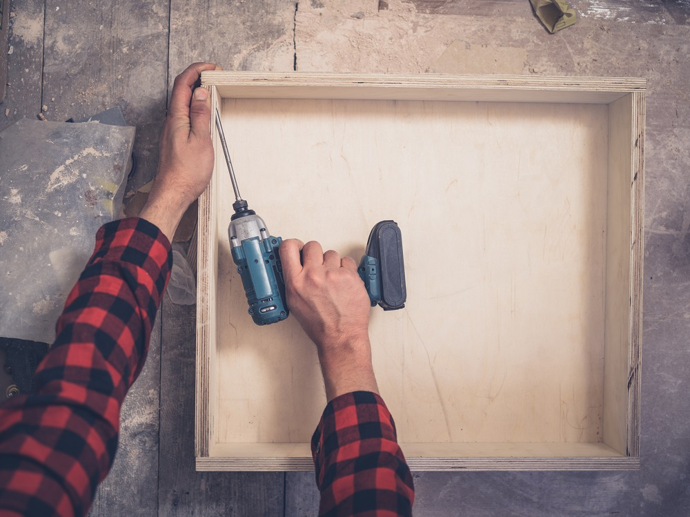 carpenter using an impact driver