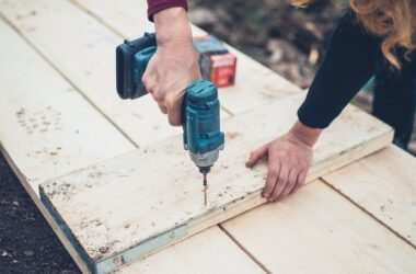 A young woman is using an impact driver