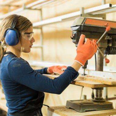 woman using a drill press