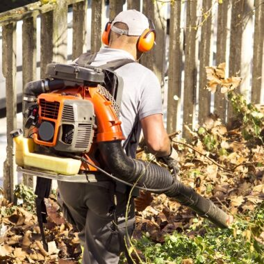 backpack leaf blower on the back of a man