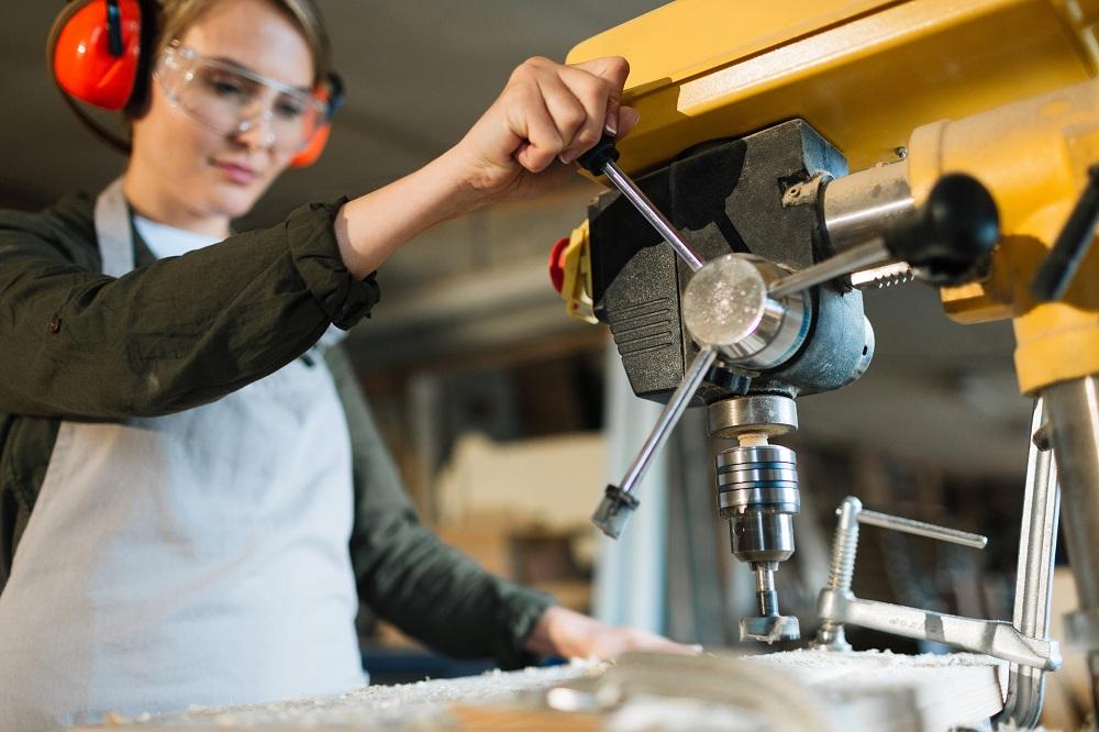 Female operator of drill press