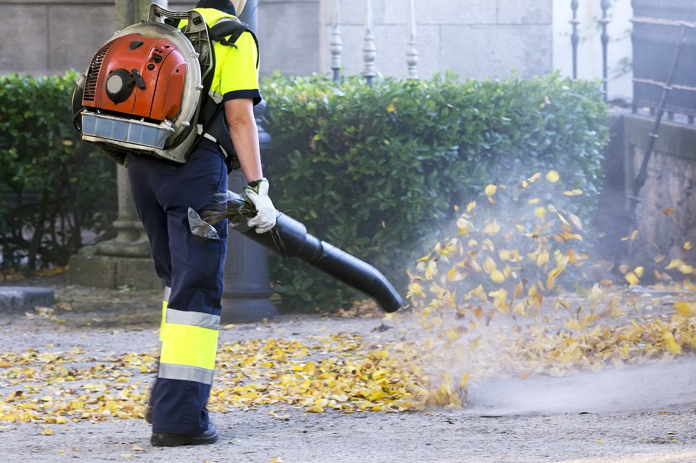 man working with a leaf vacuum