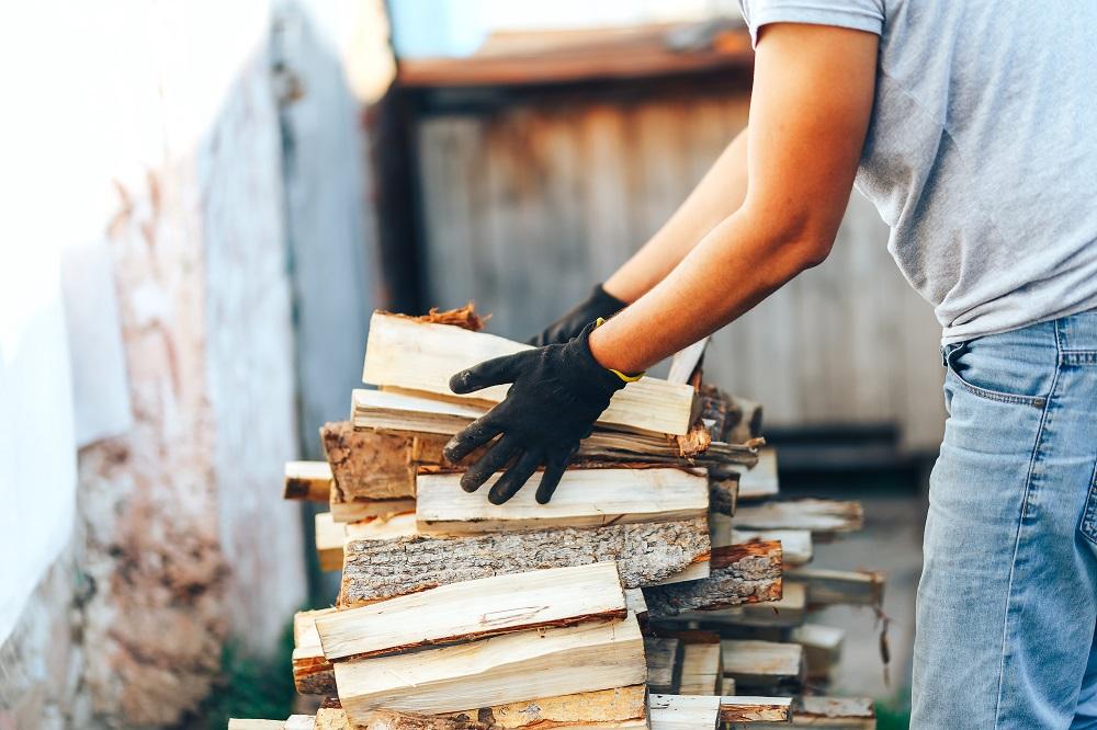 man stacking wood properly