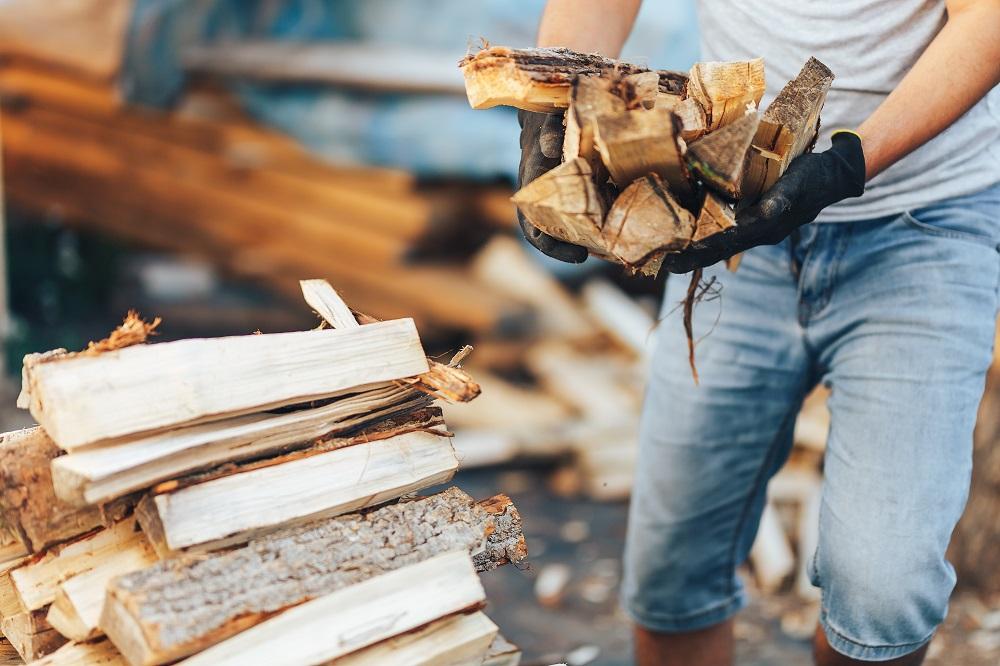 man stacking firewood